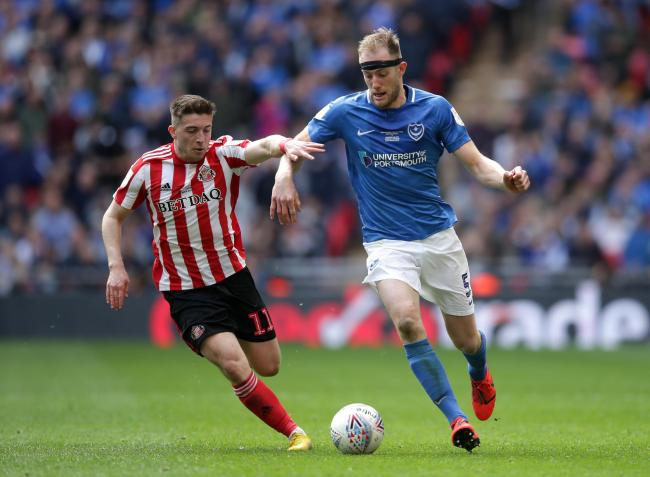 Sunderland's Lynden Gooch (left) and Portsmouth's Matt Clarke battle for the ball during the Checkatrade Trophy Final at Wembley Stadium, London. PRESS ASSOCIATION Photo. Picture date: Sunday March 31, 2019. See PA story SOCCER Final. Photo credit