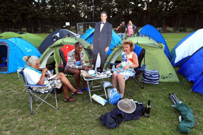 Campers from Bristol and Cheshire with a cardboard cut out of Rafael Nadal as they queue for the first day of the 2019 Wimbledon Championships at the All England Lawn Tennis and Croquet Club. Picture: Mike Egerton/PA Wire