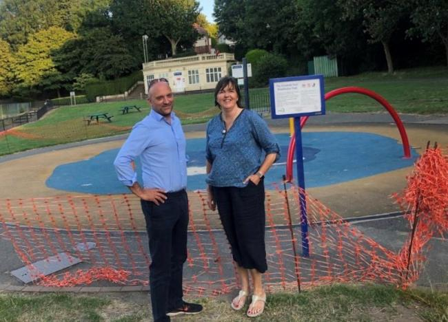 Cllr Ed Gretton & Cllr Oonagh Moulton by the closed Elisabeth Pool in Wimbledon Park