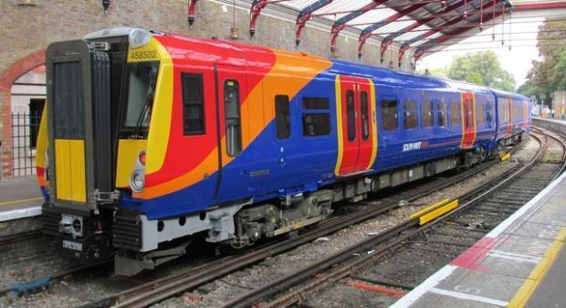 Trains delayed for up to 15 minutes due to an incident that took place between Wimbledon and Vauxhall.