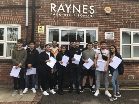 Students from Raynes Park High School Sixth Form with their results