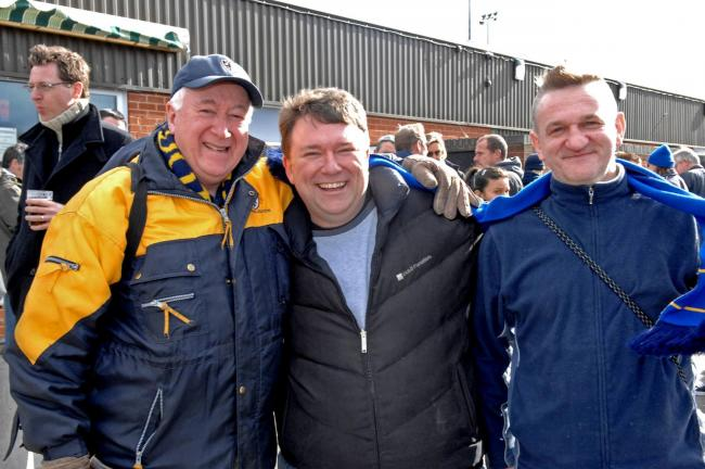 Founder member of AFC Wimbledon football club Kris Stewart (middle) at the ground during his election campaign