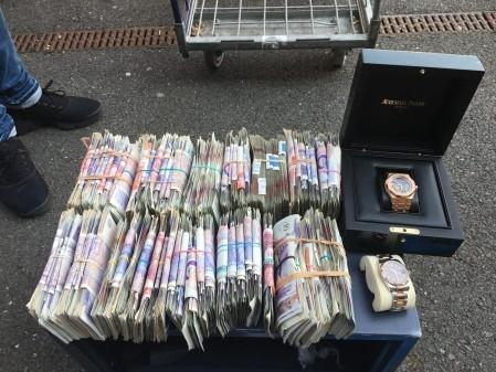 The cash seized after a Met Police operation in south west Londonm mainly Wandsworth, targeting county lines drug supplies.