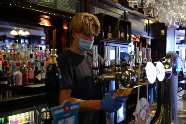 A pub reopens in North London. The easing of restrictions allows businesses including pubs restaurants and hair salons, to reopen to members of the public with measures in place to prevent the spread of the coronavirus. Image: Aaron Chown/PA Wire
