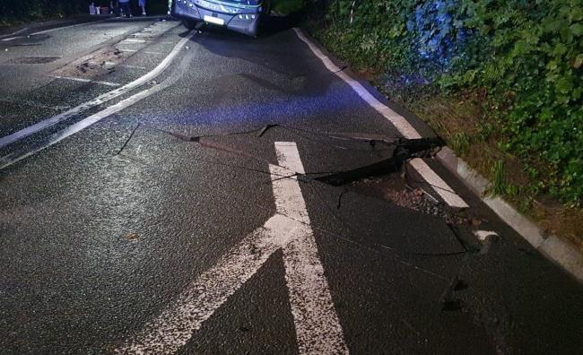 A burst water main damages the road and creates a sink hole on the A371 junction overnight. Image: @AFRSWinscombe/PA Wire