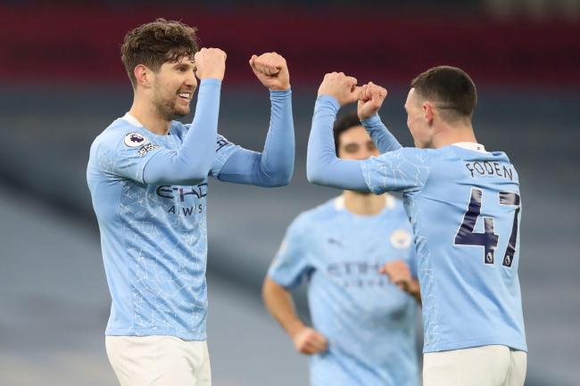 John Stones and Phil Foden celebrate