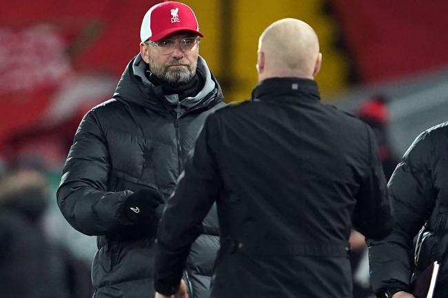 Jurgen Klopp (left) on the touchline