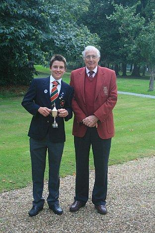 Champion: David Boote receives the Surrey Junior Masters trophy from Surrey Golf Union president Martin Christmas