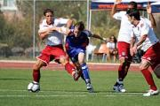 Sam Nicholson playing for Ventura Fusion against Michael Brown and Hayden Mullens from Portsmouth FC in California.