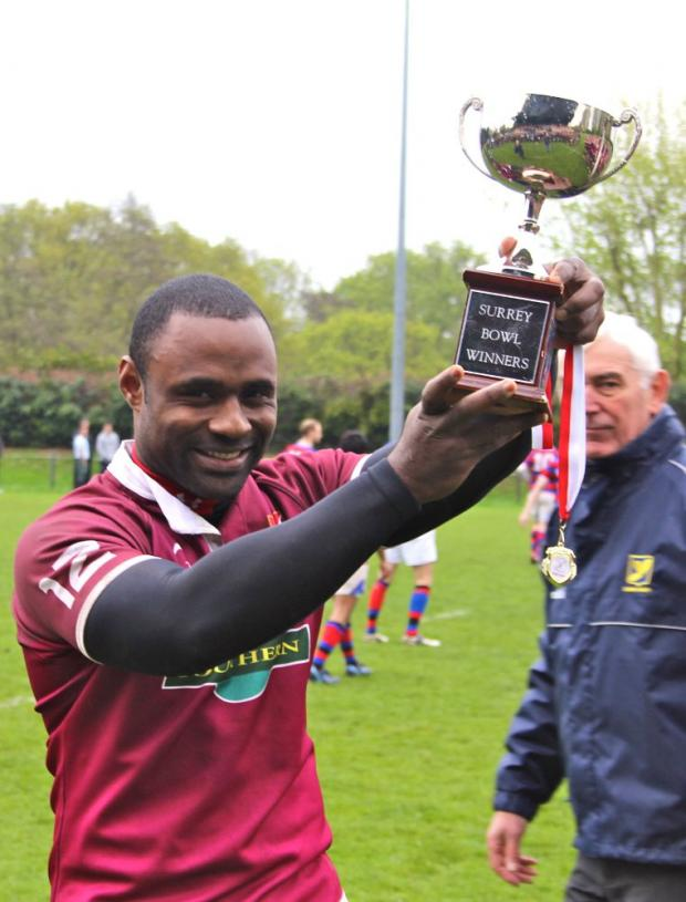Happy days: Garvin Toussaint with the trophy