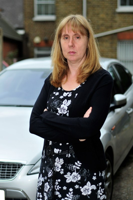 Woman fined after parking ticket 'curls up'
