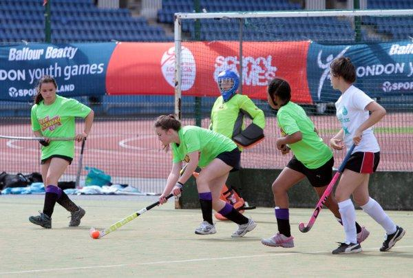 Solid defence: Richmond's hockey girls clear their lines at the Crystal Palace National Sports Centre last week