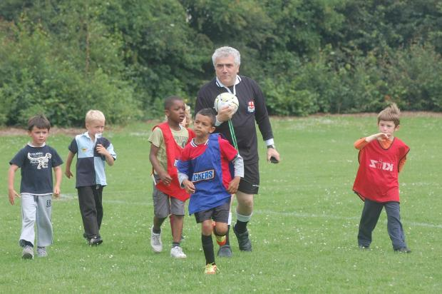 Wimbledon Guardian: Council leader Stephen Alambritis, who happens to be a qualified football referee, showed his support for the little league by officiating football trials at Colliers Wood recreation ground.
