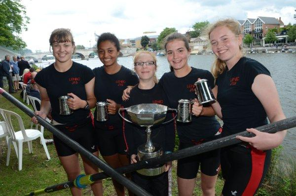 Silverware: Lady Eleanor Holles School's intermediate girls coxed four Amy Ploglase, Lea Ogunlami, Celia Davies (cox), Carmen Traseira and Elizabeth Hogle celebrate their win over Oxford University Women's Boat Club
