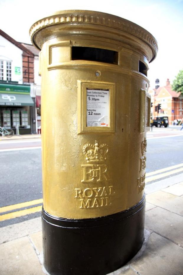 Post box painted gold in honour of Olympic champion