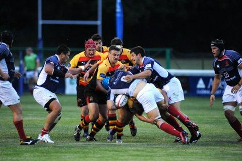 Getting stuck in: Action from last Friday's friendly clash between Richmond and London Scottish 	RT69877