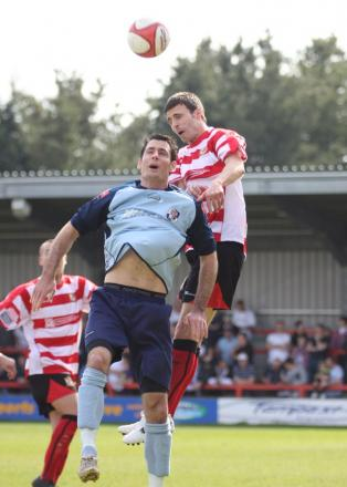 Max Hustwick in his days as a Kingstonian defender, now he is leading the back line at the Beveree
