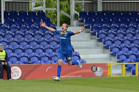 On song: Jack Midson celebrates his goal for the Dons against Dagenham & Redbridge     SP68704