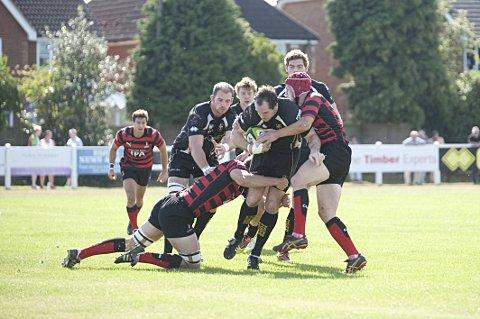 Charging: Esher's Andy Wright is halted by Blackheath last weekend
