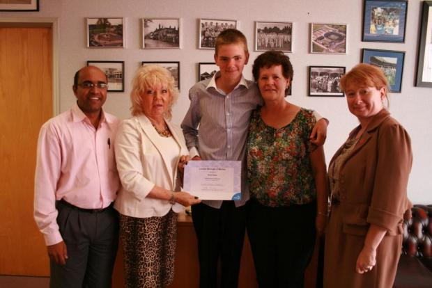 Kevin Fisher (centre) was commended for bravery by Merton Council