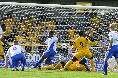 Leveller: Sutton's Craig Dundas scores the equaliser in Saturday's 1-1 draw with Havant & Waterlooville