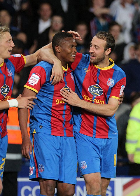 Wimbledon Guardian: Dikgacoi is congratulated by Dean Moxey and Glenn Murray
