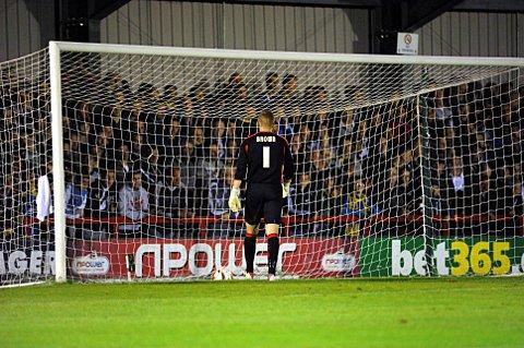 Down and out: A dejected Seb Brown collects the ball that rebounded off Rene Howe and spelled the end for Terry Brown   KT70392