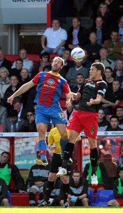 Glenn Murray challenges for a header with ex-Eagle Mark Hudson