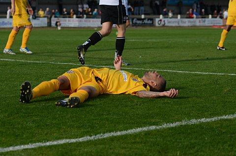 Down and out: Craig Watkins takes a quick breather in the FA Cup defeat to Bromley 		             SP68721