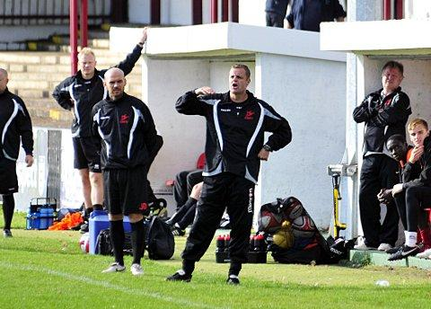 Keeping the hot seat warm: Ian Hazel (centre) oversaw the FA Trophy win over Heybridge Swifts on Saturday, but he will not be doing it on a permanent basis    SP68722