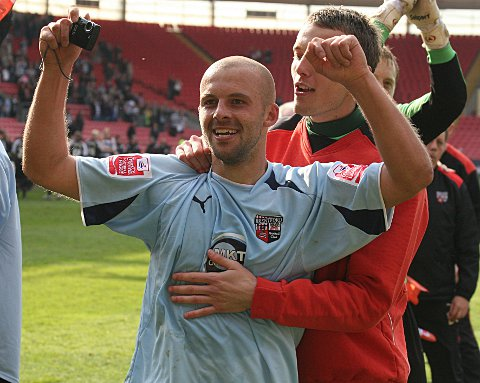Happy days: David Hunt celebrates winning the League Two title with Brentford in 2009