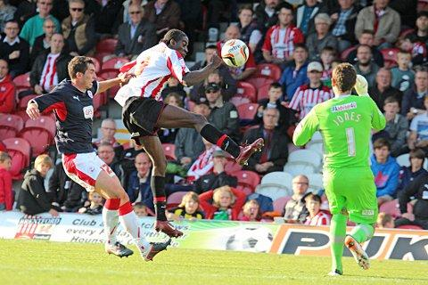 First to the ball: Clayton Donaldson flicks the ball past Crawley keeper Paul Jones for Saturday's winner