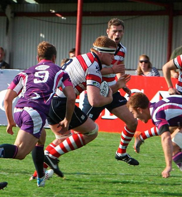 Wimbledon Guardian: Park on song: Hugo Ellis piles into the Loughborough defence during Park's 38-19 win        David Whittam
