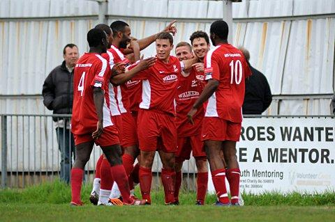 Happier days: Paul Vines (second right) celebrates a goal against Hastings United last season     SP63623