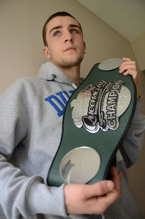 Haymaker: Ex-Teddington School student Danny Parsons, left, with the spoils of war after his Queensbury League southern area lightweight title triumph