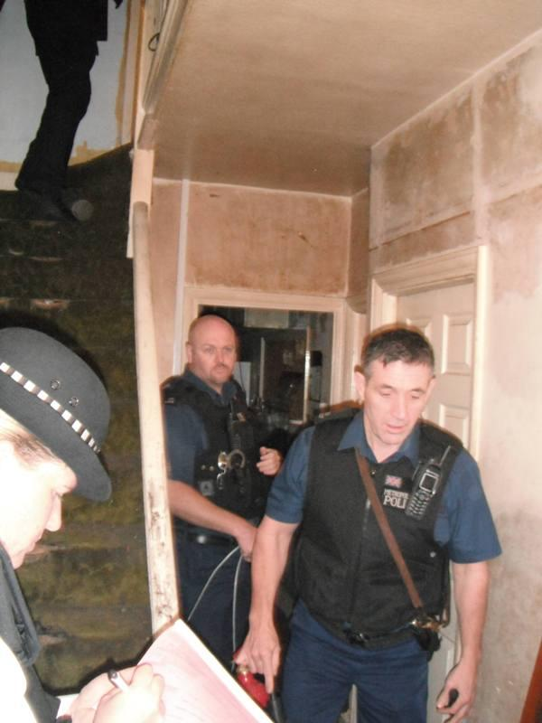 Shotgun and drugs seized after dawn raids in Merton