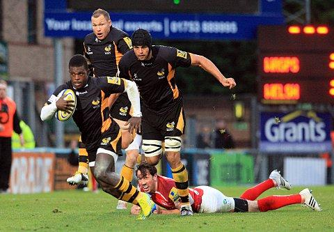 Twinkle toes: Christian Wade leaves London Welsh new boy Tom Voyce - signed last week - in his wake on Sunday