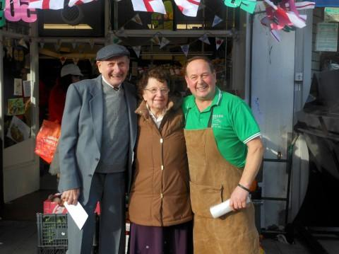 Charles, Amy and Martin Stear outside Charles Fredric Stear Greengrocers