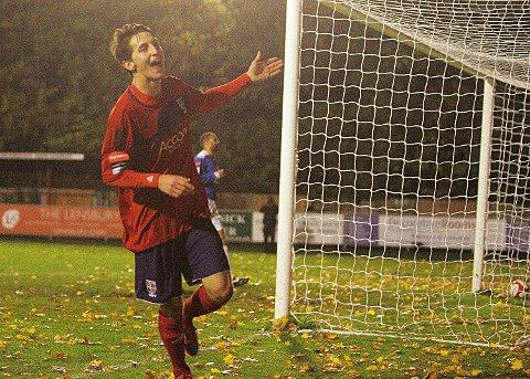 On our way: Charlie Moone slots celebrates his second goal and Hampton's third in Tuesday's 3-2 win over Leiston