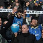 Wimbledon Guardian: Travelling army: Dons fans state their case during the FA Cup defeat at Stadium MK on Sunday             	Picture: MK Citizen
