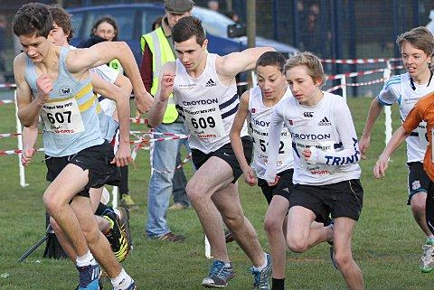 Holly good show: Harriers' Patrick Lucas, centre, finished third in the U17s Holly Run race      Rod Harrington