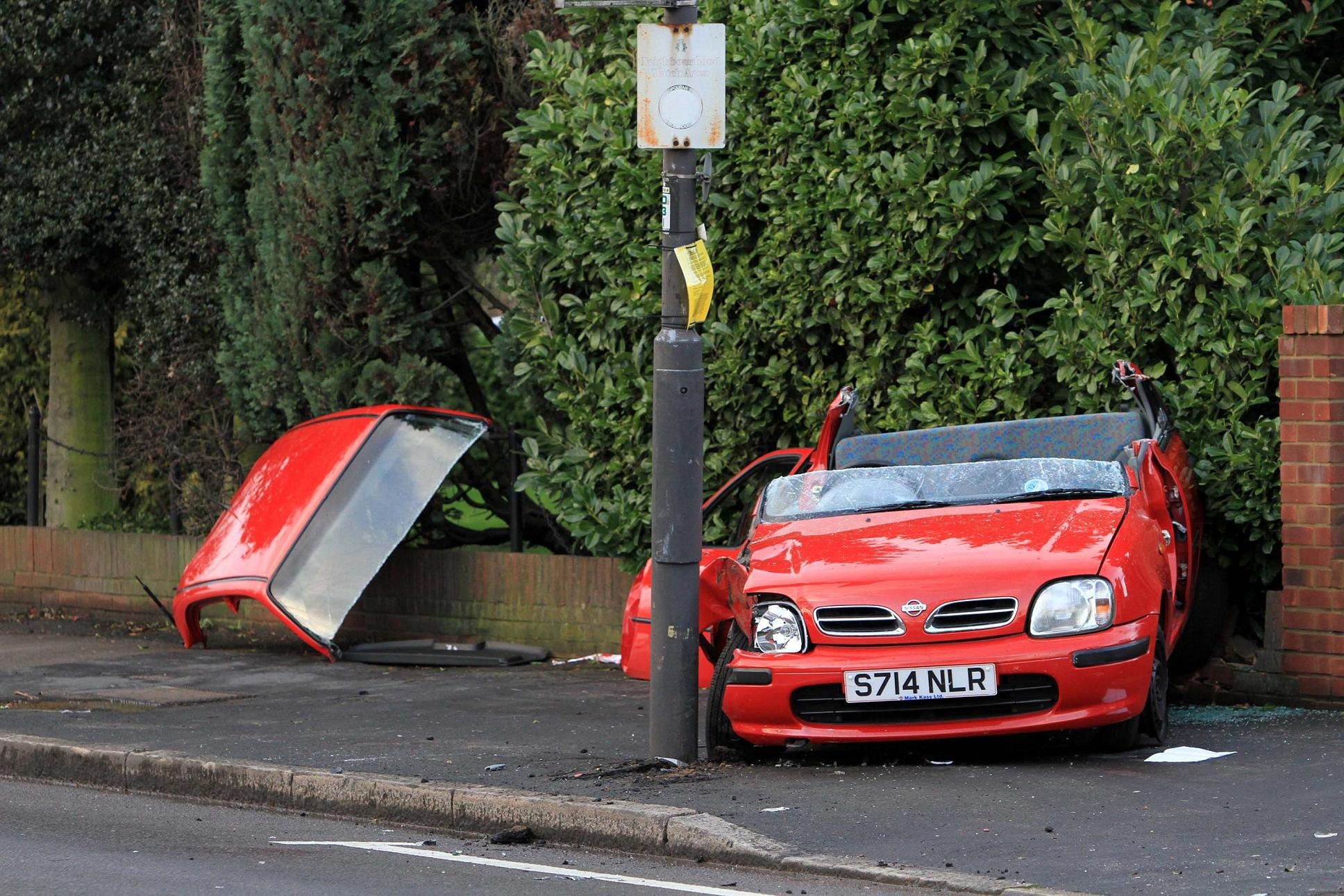 Road closed after car smashes into lamppost