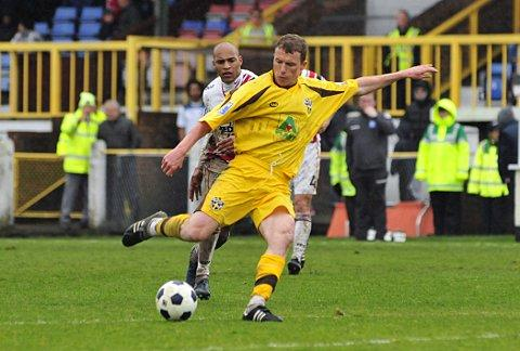 Tricky: Hampton new boy Tony Taggart in action for Sutton United last season