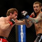 Wimbledon Guardian: Hitting out: Brad Pickett lands one on Eddie Wineland on Saturday   Picture: Josh Hedges
