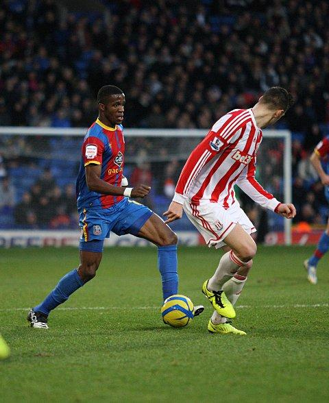 Teaser: Wilfried Zaha teases the Stoke City defence in a way only he knows how - but on this occasion he would not be able to make the breakthrough   SP72883