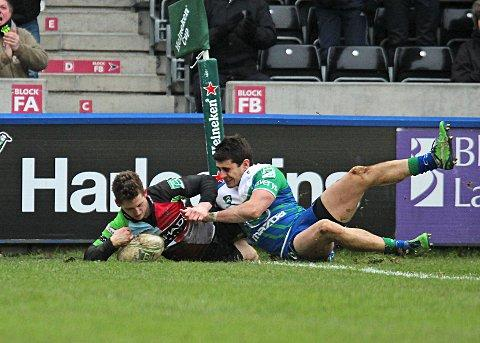 Doubled up: Winger Tom Williams scores the first try in his second half double