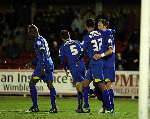 I've scored a goal: Jack Midson is congratulated by his team-mates after bagging a second goal in Thursday night's 2-2 draw with Port Vale   SP73498