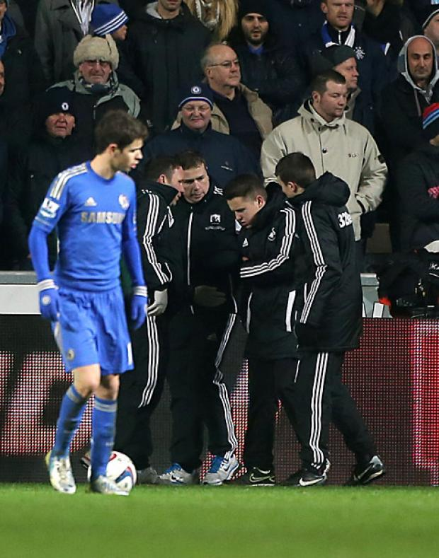 Wimbledon Guardian: Ball boy Charlie Morgan is led away after being kicked by Chelsea's Eden Hazard