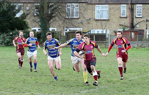 On the charge: Streatham-Croydon's Tom Watson moves through the Worth Old Boys lines    SP72944