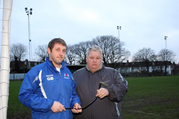 Team captain Gavin Bulger and reserve team manager Terry Tuvey with the torn cables